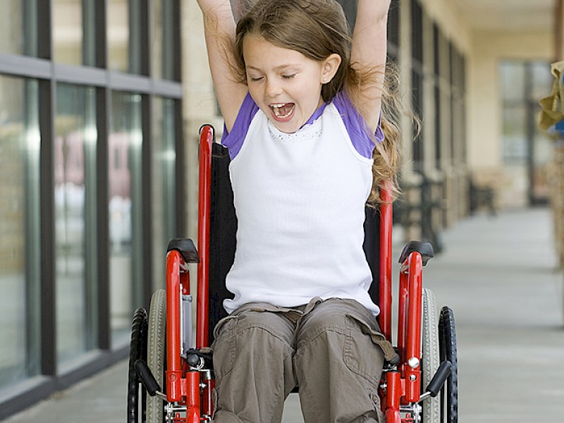 Happy Girl in Wheelchair