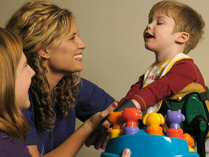 Happy Therapists with Autistic Child